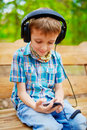 Young boy listening to music on headphones stereo Stock Photography