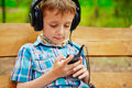 Young boy listening to music on stereo headphones Royalty Free Stock Photos