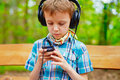 Young boy listening to music on stereo headphones Stock Images