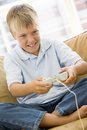 Young boy in living room with video game Stock Photos