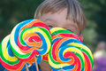 Young Boy with lollipops Royalty Free Stock Photography