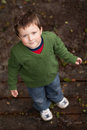 Young boy looking up smiling Royalty Free Stock Photography