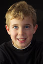 Young Boy Looks Quite Mischievious Royalty Free Stock Photo
