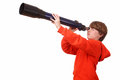 Young boy looks through a telescope on white background Royalty Free Stock Images