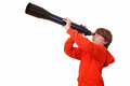 Young boy looks through a telescope on white background Stock Image