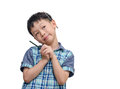 Young boy looks thoughtful with slight smile while holding pencil on white background Stock Photos