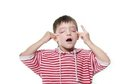 Young boy making faces Royalty Free Stock Photo