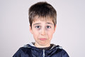 Young boy making a funny face cute grimace Stock Photo
