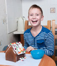 Young boy making gingerbread house Royalty Free Stock Photo