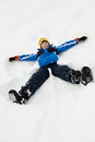 Young Boy Making Snow Angel On Slope Stock Photos