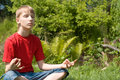 Young boy meditation Stock Image