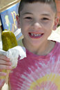 Boy with Dill Pickle Royalty Free Stock Photo