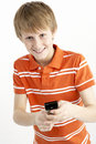 Young Boy With Mobile Phone Stock Photo