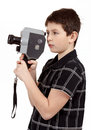 Young boy with old vintage analog mm camera looking to viewfinder Royalty Free Stock Photography