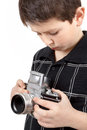 Young boy with old vintage analog slr camera looking to viewfinder Royalty Free Stock Photography