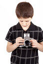 Young boy with old vintage analog slr camera looking to viewfinder Stock Photos