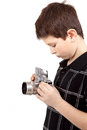 Young boy with old vintage analog slr camera looking to viewfinder Stock Photography