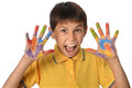 Young boy with painted hands expressing joy isolated over white background Royalty Free Stock Image