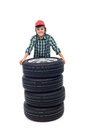 Young boy passionate about automobiles standing with four new tires isolated Royalty Free Stock Photography