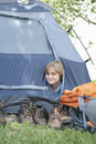 Young boy peaks out of tent portrait a smiling peaking Stock Photography