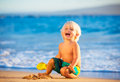 Young boy playing at the beach Royalty Free Stock Photo