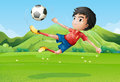 A young boy playing football at the field illustration of Royalty Free Stock Photo