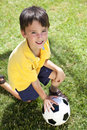 Young Boy Playing With Football or Soccer Ball Royalty Free Stock Image