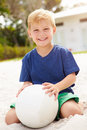Young Boy Playing Game Of Volleyball In Garden Royalty Free Stock Photo