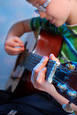 Young boy playing guitar the classical on stage Royalty Free Stock Images