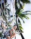 Young boy playing happy in beach hammock Stock Photography