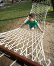 Young boy playing happy in beach hammock Royalty Free Stock Photography