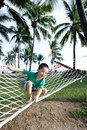 Young boy playing happy in beach hammock Royalty Free Stock Photo