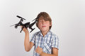 Young boy playing with hist drone