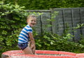 Young boy playing in an inflatable pool Royalty Free Stock Photo