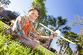 Young Boy Playing WIth Model Airplane Outside Stock Image