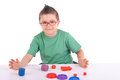 Young boy playing with modeling clay Royalty Free Stock Photo
