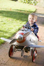 Young boy playing outdoors in airplane smiling Stock Image