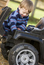 Young boy playing outdoors with toy truck smiling Royalty Free Stock Images