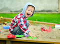 Young boy playing in the sandbox Royalty Free Stock Photo