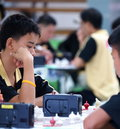 Young boy playing thai chess a a type of in thailand and surrounding nations in a local competition in khon Stock Photos