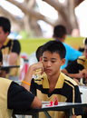 Young boy playing thai chess a a type of in thailand and surrounding nations in a local competition in khon Stock Photography