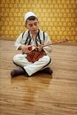 Young boy playing traditional string instrument Royalty Free Stock Images