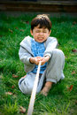 Young boy playing tug-of-war Royalty Free Stock Images
