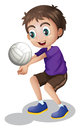 A young boy playing volleyball Royalty Free Stock Photo
