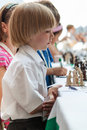 Young boy plays chess playing on the competitions Royalty Free Stock Images