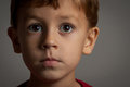 Young boy portrait with very serious face Royalty Free Stock Photo