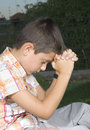 Young boy praying Stock Image