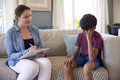 Young Boy With Problems Talking With Counselor At Home Royalty Free Stock Photo