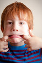Young boy pulling a face Royalty Free Stock Photo
