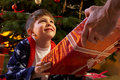 Young Boy Receiving Christmas Present Stock Photography